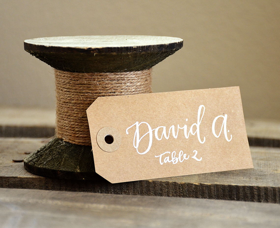 https://print.arcdesign.sk/images/products_gallery_images/your-new-friend-sam-calligraphy-handwritten-name-tag-wedding-placecards-kraft-with-white-table-seating.jpg
